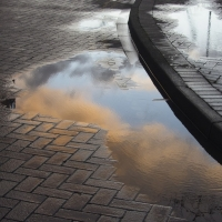 Sunset in puddle